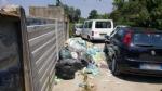 CARMAGNOLA - Appuntamento a «Carmagnola beach» per i forzati della tintarella, ma sulla spiaggia restano troppi rifiuti - immagine 6